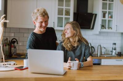 A couple using a laptop
