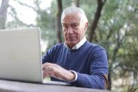 Elderly gentleman on a laptop