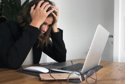 Frustrated woman with a laptop