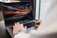 Laptop with a picture of fast city lights on the screen