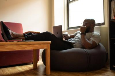 Man relaxing with a laptop